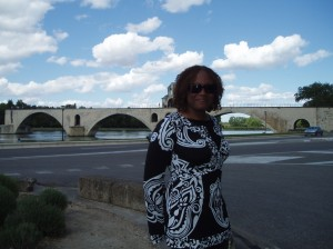 During a break from a wine-tasting tour, I'm standing in front of the Pont d'Avignon in the lovely Provencal town of Avignon. And this is me some days AFTER my stop to a black hair-care supply shop in Nice. Thank goodness black folks literally live everywhere!