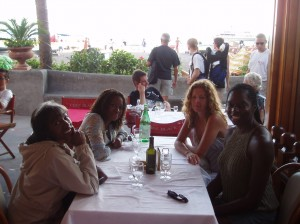 I first met my now-good friend Kelly Carter (right front) in Italy back in Fall 2004 after an introduction from a mutual Chicago journalist friend. Here we were (each of us with a mutual friend) having drinks at a beachfront restaurant in scenic Positano, where Kelly then lived.