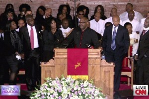 "Pastor Marvin Winans (center), surrounded by several musical members of the Winans family, shared their hit ""Tomorrow"" with the worldwide funeral audience."